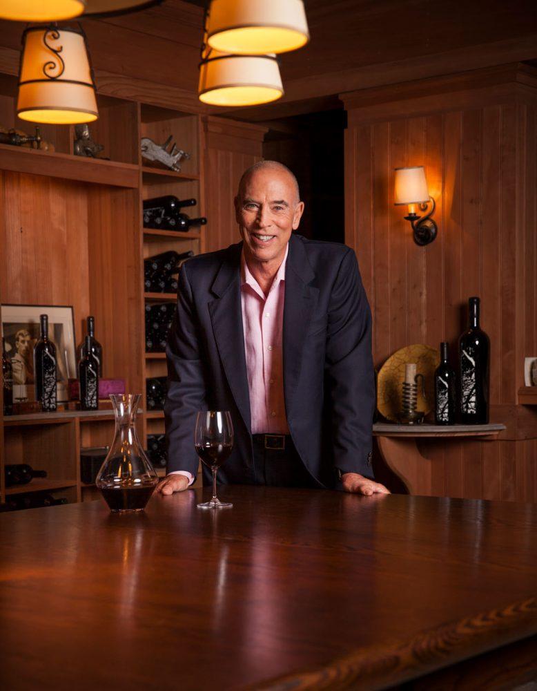 Michael Mondavi in wine cellar